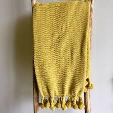 mustard home decor cotton throw with pom pom edge u2013 living roots home decor
