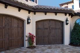 garage door repair santa barbara our faux wood carriage house style garage doors add curb appeal to
