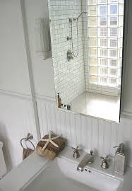 glass block window living room transitional with medium hardwood
