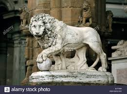 lion statue sculpture of lion in florence italy stock photo royalty free