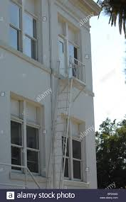 emergency exit ladder and stairs painted white to match the side