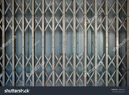 Metal Door Designs Old Folding Metal Door Gate Stock Photo 418869922 Shutterstock