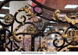 details structure ornaments wrought iron fence stock photo