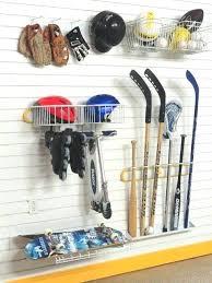 sport storage solutions includes a skate rack stick rack shelf