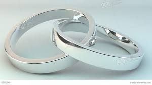 wedding rings together wedding rings joined together against a white background stock