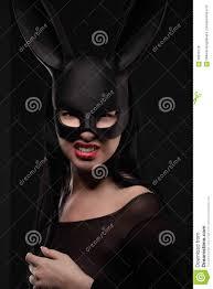 rabbit mask halloween beautiful charming woamn in black rabbit mask and elegant