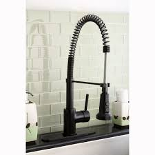 rubbed bronze pull kitchen faucet kingston brass concord modern rubbed bronze spiral pull