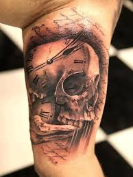 tattoo meaning skull picture of a clock skull and bone tattoo meaning how fast the time goes