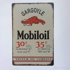 gargoyle home decor gargoyle mobiloil vacuum oil company retro vintage metal tin sign