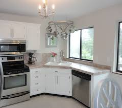 white wooden cabinet with silver steel stove also fridge placed on