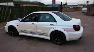 white subaru car subaru