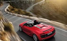 Audi R8 Rental - red audi r8 running fast on a winding road never compromise on