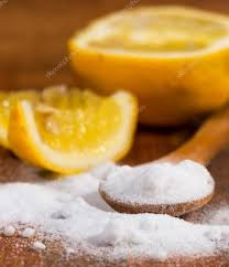 bicarbonate en cuisine baking soda sodium bicarbonate in a wooden spoon and lemon stock