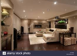 home theater projection screen basement in luxury residential home with sofa and large projection