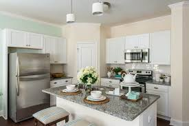 traditional kitchen with l shaped u0026 pendant light in snellville
