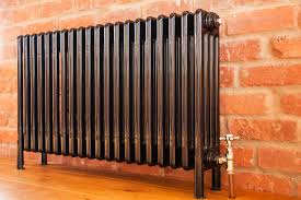 wood and metal radiator covers beautifying the beast