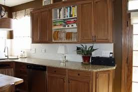 brown textured wood cabinet combine black countertop kitchen