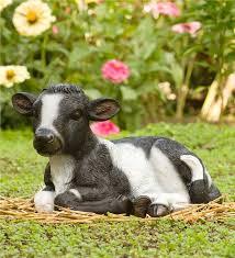 baby cow garden statue in garden sculptures