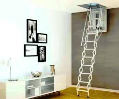 pull down stairs folding attic access ladder in a garage 9547