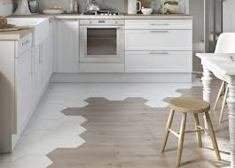 tile floors kitchen with black and white cabinets griddle for