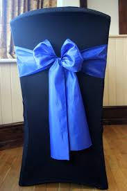 royal blue chair covers black chair with gold lace to the moon and back weddings