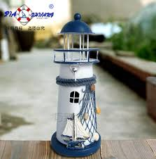 blue and white shell fishing net metal decoration lighthouse mousse
