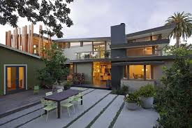 gorgeous home with modern design and alluring brick flooring under