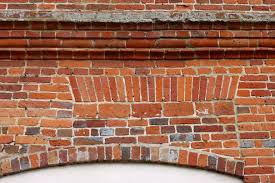window infill including a top course of sailors brick arches