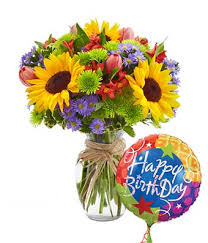 floral garden with birthday balloon at from you flowers