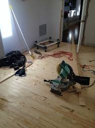 Real Wood Or Laminate Flooring How We Installed Real Wood Floor For Less Than 1 50 Per Square Foot