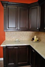 black stain on kitchen cabinets stained maple kitchen cabinets granit countertop real