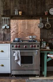 trending on remodelista the summer kitchen copper backsplash