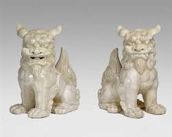 pictures of foo dogs pair of white ceramic foo dogs mecox gardens