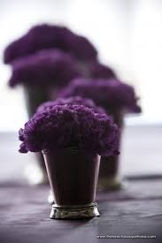small purple carnations in dainty silver vases for floral
