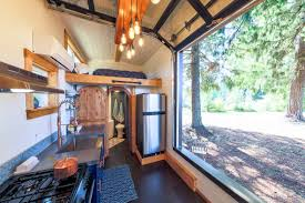 tiny heirloom micro cabin boasts spilt level living space and a