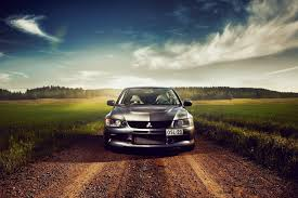 cars mitsubishi lancer evolution car clouds tree grass light sky road vehicles black car