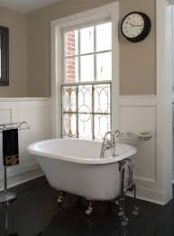 bathroom white clawfoot tub with silver legs and stone wall plus all images