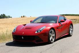 Ferrari F12 On Track - video autocar reviews the ferrari f12 berlinetta on track and
