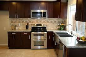 small kitchen ideas with brown cabinets 20 small kitchen makeovers by hgtv hosts small kitchen