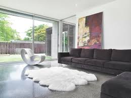 bedroom modern living room design with dark sectional sofa and