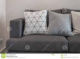 Modern Gray Sofa by Graphic Pattern Pillows On Modern Grey Sofa Stock Photo Image
