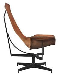 pair of swivelling leather sling chairs by william katavolos