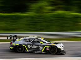 lime green bentley bentley team absolute travels to road america with one entry