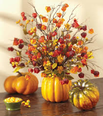 love the pretty fall colors in this pumpkin flower arrangement