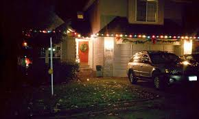 colorful christmas lights on house cheminee website