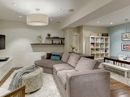 epic bright themed basement remodel with gray sectional sofa and