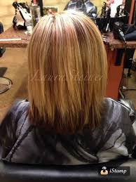 mid length haircut with blended layers highlights and lowlights