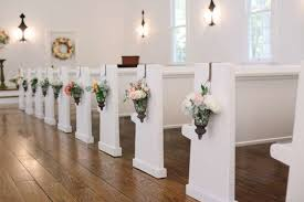 pew decorations fresh flowers in hanging lanterns as pew decorations weddingday