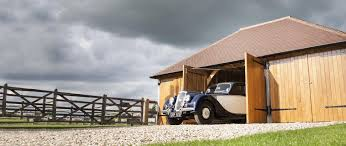 oak framed garage specialists oak designs co 3 bay bespoke garage classic car