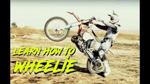 how to start motocross racing learn to wheelie a dirt bike how to wheelie youtube